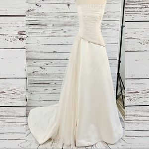 Maggie Sottero blush wedding gown beaded strapless
